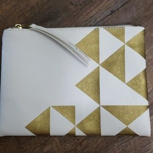 Moving Comfort toiletry bag. White and gold